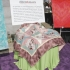 The quilt auctioned at the Heroes & Hearts luncheon was made from richly colored Asian fabrics with the heart theme to celebrate Valentine's Day and Lunar New Year.